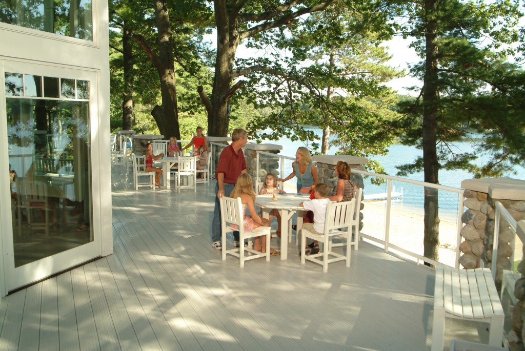 The wrap-around deck overlooks the beach and the lake.